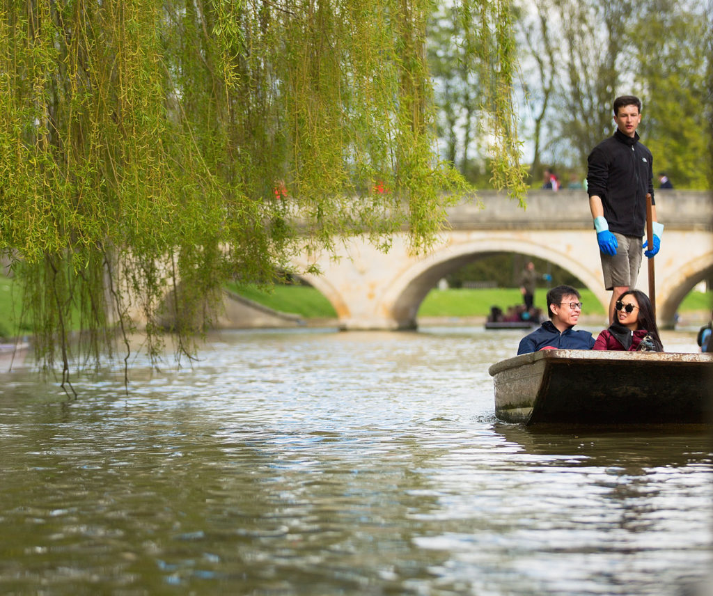 couple punting along the river in Cambridge