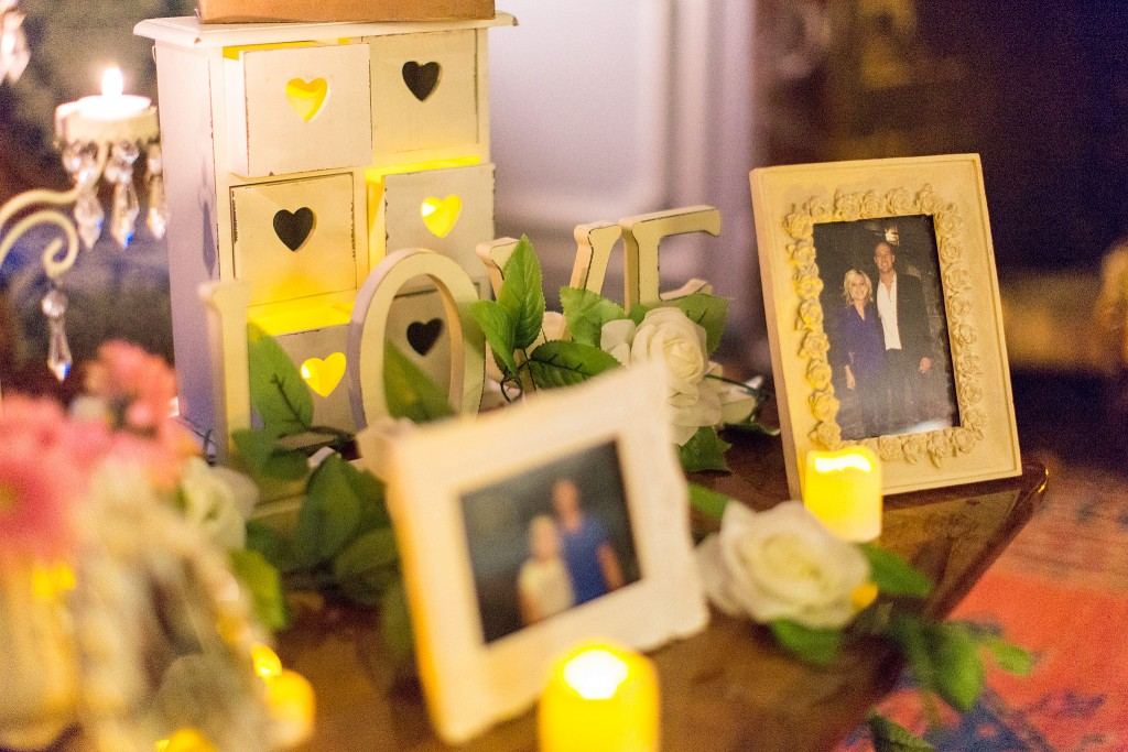 …and a table full of candles, love letters, and pictures of them...