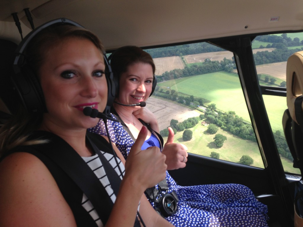 Cloe and proposer Daisy in the helicopter.