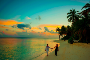 A couple walking on a beach in the Maldives