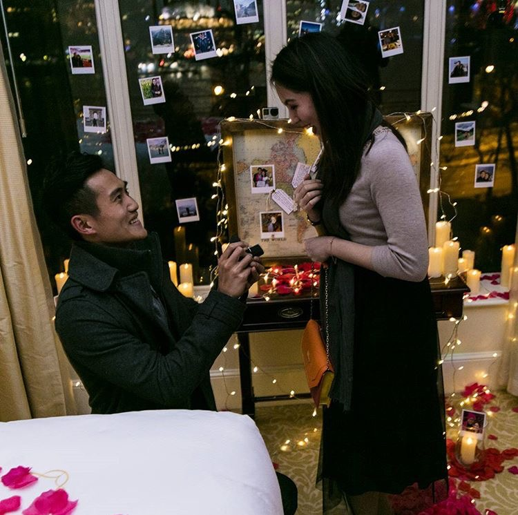man down on one knee asking his girlfriend to marry him in The Savoy Hotel