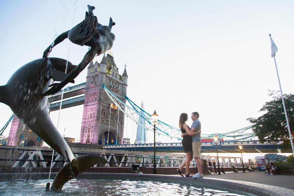 Proposing in London next to the Dolphin fountain overlooking Tower Bridge.