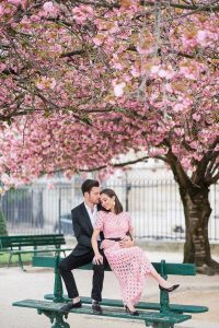 paris engagement photographer portrait under the cherry blossoms in Paris