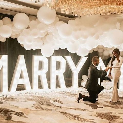 """Bringing a whole new meaning to LOVE IS IN THE AIR 💍😍  John wanted the 'wow factor' for his girlfriend, Xio 💍 so we came up with the idea together of a proposal """"in the clouds"""", with @theshardlondon @shangrilalondon being perfect for romance high in the sky ☁️💍  🎈 @bubblegumballoons supplied the amazing balloons for this proposal 🎈While the whole room was decorated with white decorations to match the elegant feel of the clouds, with white petals, candles and a majestic Marry Me sign.  A harpist played All of Me by John Legend as Xio entered, and serenaded the couple throughout.  Talk about feel good Friday 😍  #theproposers #theshard #londonproposal #london #shard #shangrila #howheasked #huffpostido #proposal #marriageproposal #engaged #engagedcouple #thatsdarling #theknot #loveauthentic #weddingseason #mclaren #thedailywedding #justengaged #engagementsession #shangrilahotel #balloons #hotairballoon #engagementring #marryme"""