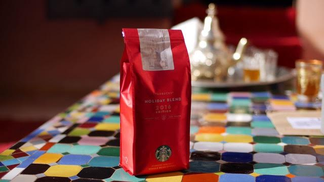 Bag of Starbucks coffee on a table as part of a marriage proposal in Morocco planned by proposal experts The Proposers.