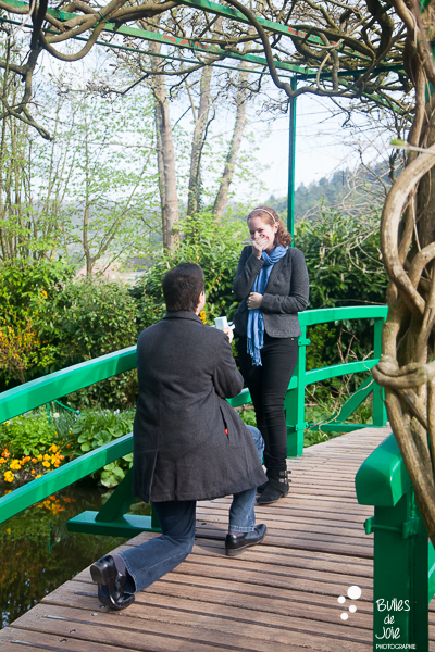 After leading Celina through the beautiful gardens of the Monet Foundation, Denis lead her onto the bridge where he got down on one knee and asked her to marry him...