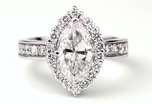 Designed by Seven Stone, this stunning marquis diamond ...